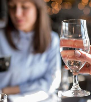 Girl Tasting Water in Glass