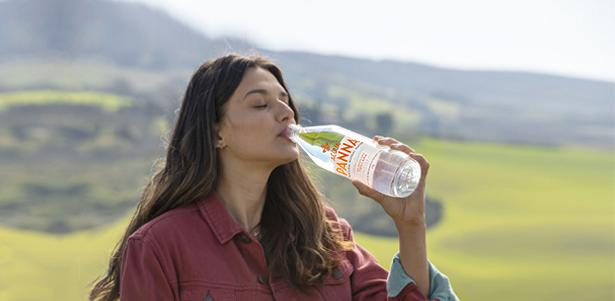 Girl drinks Acqua Panna in Tuscany CSV