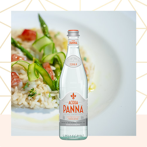 orzo dish on white plate with 750 ml acqua panna glass bottle
