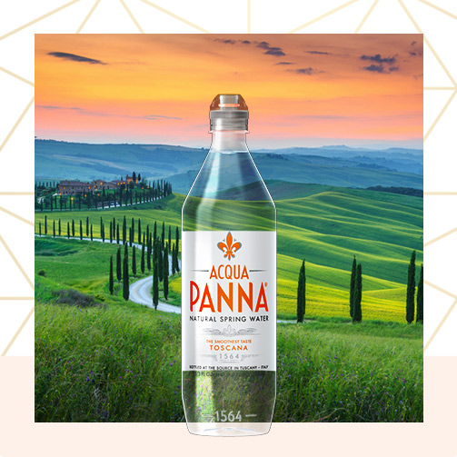 tuscan landscape at sunset with 750 ml acqua panna plastic sport water bottle