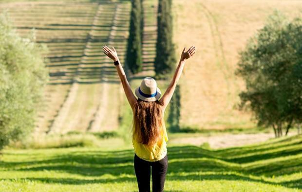 woman embracing tuscan countryside - discover life changing experiences you must try in tuscany