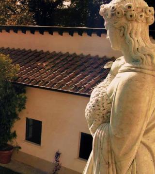 italian statue overlooking villa panna in tuscany